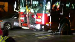 Firetruck stuck in sinkhole at night Stock Footage