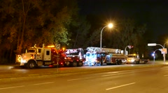 Large scale towing operation with broken down fire-truck Stock Footage