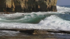 Waves lapping on the rocky coast - stock footage
