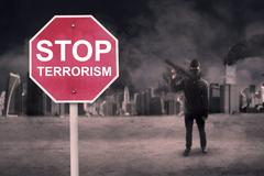 Stop Terrorism text with male terrorist - stock photo