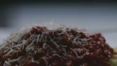 Grating cheese on spaghetti time lapse Stock Footage