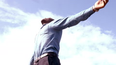 Standing man with outstretched arms Stock Footage