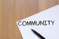 Stock Photo of Community write on notebook