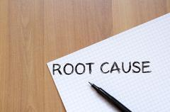 Root cause write on notebook - stock photo