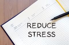 Stock Photo of Reduce stress write on notebook