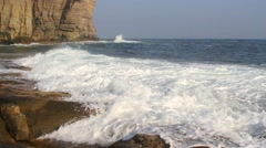 Waves lapping on the rocky coast Stock Footage