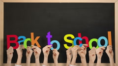 Hands holding up back to school - stock footage