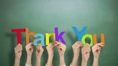 Hands holding up thank you - stock footage