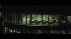 City night time offices with empty desks lined up Stock Footage