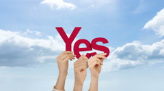 Hands holding up yes - stock footage