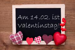 Blackboard, Textile Hearts, Text 14.2 Valentinstag Means Valentines Day Stock Photos