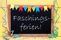 Chalkboard With Party Decoration, Text Faschingsferien Means Carnival Vacation Stock Photos