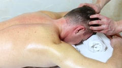 Man doing sports massage at the massage parlor Stock Footage