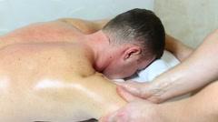 Man doing sports massage Stock Footage