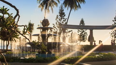 round fountain operates changing jets in tropical park - stock footage