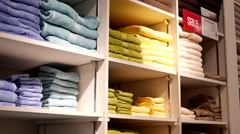 Stock Video Footage of Stack of color towels on display for sale inside Sears store