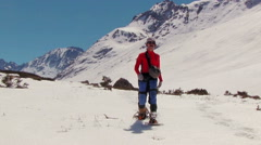 Climber with snowshoes  Stock Footage