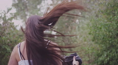 A beautiful girl with long hair running away from the camera, slow motion - stock footage