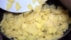 Frying potatoes Stock Footage
