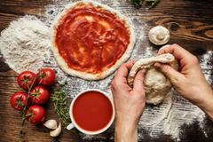 Fresh original Italian raw pizza preparation - stock photo