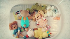 A box with colorful toys and dolls and colorful from a bird's-eye view. Stock Footage