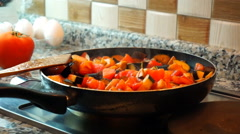 beautiful woman casually cooking, stir, simmer vegetable in pan at kitchen. - stock footage
