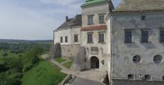 Medieval Olesko castle near Lviv city. It stands on a picturesque hill. Aerial Stock Footage