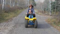 Baby and mom on 4 wheeler Stock Footage
