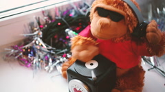 Monkey dj soft toy moving close up Stock Footage