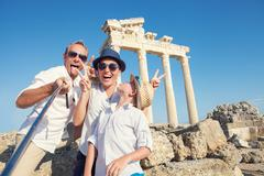 Funny family take a selfie photo on Apollo Temple colonnade view in Side, Tur - stock photo