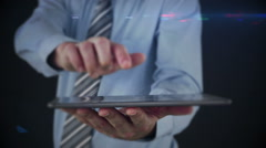 Stock Video Footage of Businessman using tablet to view hologram