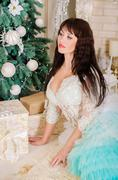 Girl in a magnificent wedding dress for Christmas. - stock photo