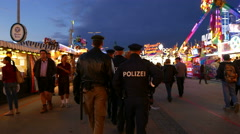 Stock Video Footage of 4K UHD Oktoberfest Policemen patrol control on duty Fairground German Munich