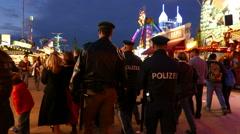 4K Oktoberfest Police patrol control on duty German Munich Beer Festival Stock Footage