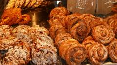 4K UHD Street Food Bee Flies sucking sweet bread cakes in Bakery display window Stock Footage