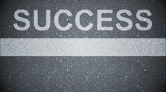 Composite video of success written on the road Stock Footage