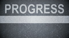 Composite video of progress written on the road Stock Footage