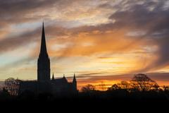 Winter frosty sunrise landscape Salisbury cathedral city in England Stock Photos