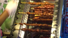 new sytle grill machine,roasted meat in guangzhou,china - stock footage
