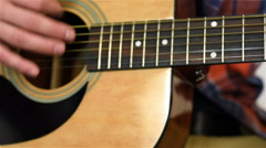 Playing At Yellow Acoustic Guitar - stock footage