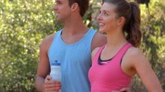 Athletic couple taking a break - stock footage