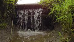 Water of an Irrigation Canal Flows Over a Wooden Dam Stock Footage