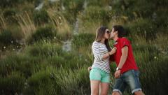 couple in love at hillside among yellow flowers - stock footage