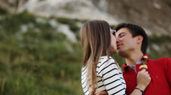 Romantic young couple kissing passionately, mountains on background Stock Footage
