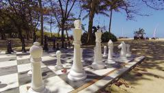 Life Size Chess Set on a Tropical Beach Stock Footage