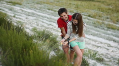 Young couple picking flowers Stock Footage
