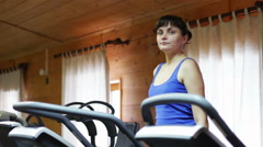 Girl on the fitness trainer at the gym Stock Footage
