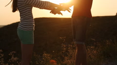 Stock Video Footage of appointment of a young couple in the mountains at sunset