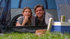 Happy couple lying in their tent Stock Footage