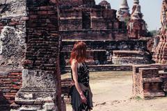 Woman exploring ancient ruins - stock photo
